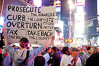 "Protesters with ""Occupy Wall Street"" in Times Square on October 15, 2011 in New York City.  While crowd estimates numbered in the tens of thousands, police tactics (including nets, motor scooters, barricades, arrests, and intimidation by riders on horseback) prevented the crowd, which had been split up, from joining together as one in the middle of Times Square."