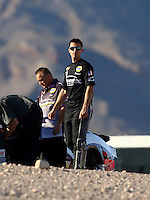 Mar 28, 2014; Las Vegas, NV, USA; NHRA pro stock driver Vincent Nobile (right) with father John Nobile during qualifying for the Summitracing.com Nationals at The Strip at Las Vegas Motor Speedway. Mandatory Credit: Mark J. Rebilas-