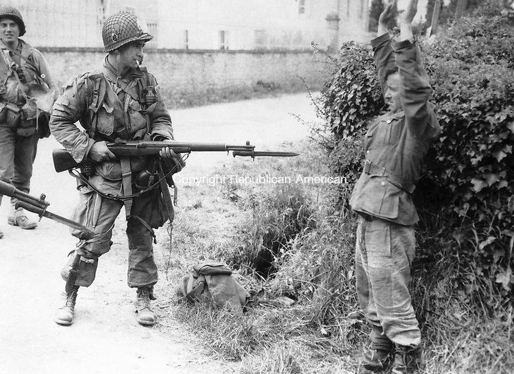 An American paratrooper holds a Nazi prisoner at the point of his bayonet, one of many incidents during the American advance into Normandy, in France, on June 10, 1944. (AP Photo)