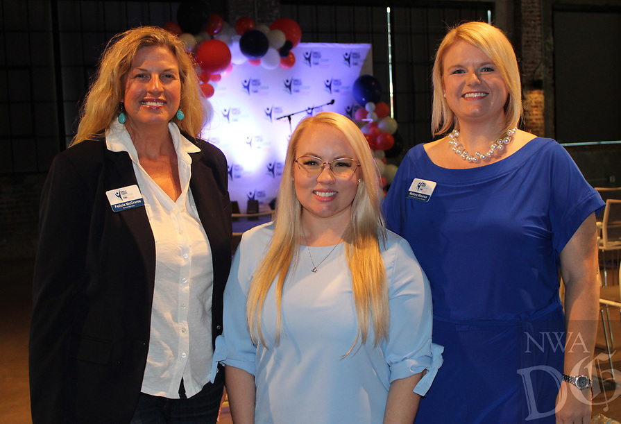 Felicia McCranie (from left), Heather Hodge and Mallory Mounce gather at the merger celebration. <br /> (NWA Democrat-Gazette/Carin Schoppmeyer)