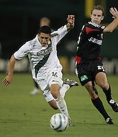 August 20, 2005: Washington, DC, USA: DC United defender Bryan Namoff (26) pushes  Los Angeles Galaxy forward Herculez Gomez (16) at RFK Stadium.  The foul led to a Landon Donovan goal off of a direct kick.