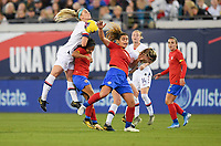JACKSONVILLE, FL - NOVEMBER 10: Julie Ertz #8 of the United States towers over a Costa Rican player advancing to the ball during a game between Costa Rica and USWNT at TIAA Bank Field on November 10, 2019 in Jacksonville, Florida.
