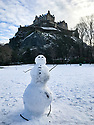 Edinburgh, UK. 29.12.2020. A socially distanced snowman enjoys the festive weather in Edinburgh's Princes Street Gardens, in front of Edinburgh Castle. This is the first snowfall of the first Covid Winter in Edinburgh. Edinburgh has been placed in Tier 4 restrictions due to the Covid-19 pandemic.Photograph © Jane Hobson.