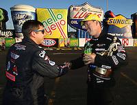 Feb 8, 2015; Pomona, CA, USA; Drew Skillman (left) congratulates NHRA pro stock driver Jason Line as he celebrates after winning the Winternationals at Auto Club Raceway at Pomona. Mandatory Credit: Mark J. Rebilas-