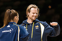 Melbourne, 14 August 2015 - Laura Hodges of the Australian Opals women's basketball team and Brad Newley of the Australian Boomers men's basketball team inspect the court at a press conference on the eve of the game one of the 2015 FIBA Oceania Championships at Rod Laver Arena in Melbourne, Australia. (Photo Sydney Low / sydlow.com)