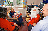 Father Christmas and his elf drop in by helicopter to visit children in The Royal Cornwall Hospital Truro Cornwall at Christmas. This image may only be used to portray the subject in a positive manner..©shoutpictures.com..john@shoutpictures.com