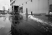 New York, New York.October 30, 2012..A pump churns out water from a building in the financial district as a result of flooding by Hurricane Sandy.