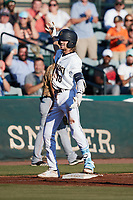 Matt Dyer (10) of the Charleston RiverDogs celebrates after hitting a triple against the Down East Wood Ducks at Joseph P. Riley, Jr. Park on September 26, 2021 in Charleston, South Carolina. (Brian Westerholt/Four Seam Images)