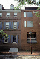 Philadelphia: Delancey St. elevations. To left, 18th Century; to right, late 20th. Note echoing of cellar doors in new building. Photo '85.