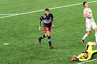 FOXBOROUGH, MA - MAY 22: Gustavo Bou #7 of New England Revolution beats Carlos Coronel #13 of New York Red Bulls during a game between New York Red Bulls and New England Revolution at Gillette Stadium on May 22, 2021 in Foxborough, Massachusetts.