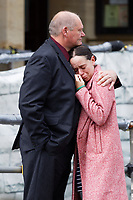 LEGAL NOTICE: THERE IS NOW A COURT ORDER PREVENTING THE IDENTIFICATION OF DANIELLE JOHN AND ANY PUBLICATION OF HER PICTURES Pictured L-R: Byron John, Bradley's father with partner Kate Pickard react after the verdict at the Coroner's Court in Llanelli, Wales, UK. Tuesday 29 June 2021<br /> Re: A verdict for a Coroner's inquest into the death of 14 year old Bradley John, who was found dead by his sister at his school, has been read out at the Coroner's Court in Llanelli, Wales, UK.<br /> Talented young horse rider Bradley John, 14, was found hanged in the school toilets by his younger sister Danielle (DANIELLE JOHN CANNOT BE IDENTIFIED AND/OR NAMED) at the 500-pupils St John Lloyd Roman Catholic school in Llanelli, South Wales in September 2018.<br /> Bradley's family claim he had been bullied for two years after being diagnosed with Attention Deficit Hyperactivity Disorder.<br /> He went missing during lessons and was found in the toilet cubicle by his sister Danielle (DANIELLE JOHN CANNOT BE IDENTIFIED AND/OR NAMED), who was 12 at the time.