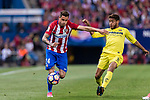 Jose Maria Gimenez de Vargas of Atletico de Madrid (L) fights for the ball with Jonathan Dos Santos of Villarreal CF (R) during the La Liga match between Atletico de Madrid vs Villarreal CF at the Estadio Vicente Calderon on 25 April 2017 in Madrid, Spain. Photo by Diego Gonzalez Souto / Power Sport Images