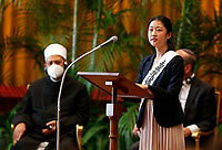 """Rev. Takako Niwano, representing Rev. Kosho Niwano, president-designate of Rissho Kosei Kai,  addresses the meeting, """"Faith and Science: Towards COP26,"""" with Pope Francis and religious leaders in the Hall of Benedictions at the Vatican Oct. 4, 2021. The meeting was part of the run-up to the U.N. Climate Change Conference, called COP26, in Glasgow, Scotland, Oct. 31 to Nov. 12, 2021."""