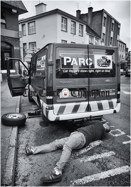 Right Man In The Right Place...Declan Ryan of PARC Car Repairs solves his own motoring issue as he changes a punctured tyre on the company van on a busy O Connell Street, Ennis, on Friday. Photograph by John Kelly.