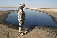 "- Italian military intervention in Iraq (10/2004), a soldier of the aiborne brigade ""Friuli"" controls a pool of oil in the desert of Dhi Qar region,  provoked by smugglers of fuel that do leaks in the oil pipe-line<br />