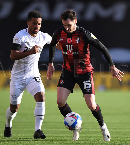 31st October 2020; Vitality Stadium, Bournemouth, Dorset, England; English Football League Championship Football, Bournemouth Athletic versus Derby County; Nathan Byrne of Derby County competes for the ball with Adam Smith of Bournemouth