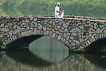SHENZHEN, CHINA - OCTOBER 31:  Peter Spearman-Burn of New Zealand crosses a bridge near in his way to the 15th hole during the day three of Asian Amateur Championship at the Mission Hills Golf Club on October 31, 2009 in Shenzhen, Guangdong, China.  (Photo by Victor Fraile/The Power of Sport Images) *** Local Caption *** Peter Spearman-Burn