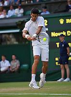 01-07-13, England, London,  AELTC, Wimbledon, Tennis, Wimbledon 2013, Day seven, Novak Djokovic (SRB)<br /> <br /> <br /> <br /> Photo: Henk Koster