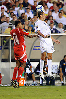 Davy Arnaud (22) of the United States (USA) and Armando Gun (14) of Panama go up for a header. The United States (USA) defeated Panama (PAN) 2-1 during a quarterfinal match of the CONCACAF Gold Cup at Lincoln Financial Field in Philadelphia, PA, on July 18, 2009.