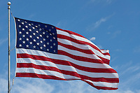 Photo of American flag waving on a bright sunny day in the Lone Star State of Texas