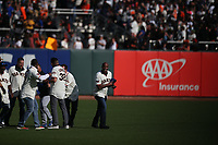 SAN FRANCISCO, CA - SEPTEMBER 29:  Barry Bonds and his former 2007 San Francisco Giants teammates walk onto the field and throws Dave Roberts' cap during a ceremony celebrating the career of manager Bruce Bochy after the game between the Los Angeles Dodgers and the San Francisco Giants at Oracle Park on Sunday, September 29, 2019 in San Francisco, California. (Photo by Brad Mangin)