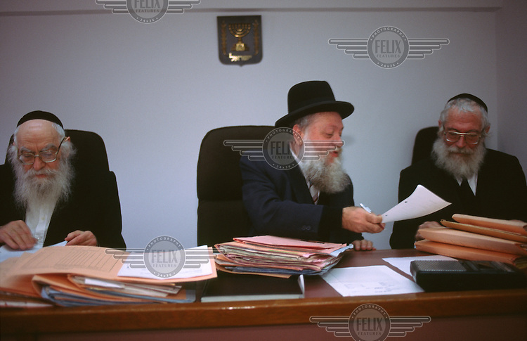 The Rabbinical court in session to grant a divorce for a woman whose husband has left her.