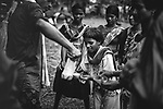 Rice beer being distributed among young girls during a marrige ceremony at Sukma. Chattisgarh, India. Arindam Mukherjee