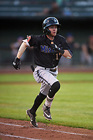 Missoula Osprey Cam Coursey (11) runs to first base during a Pioneer League game against the Idaho Falls Chukars at Melaleuca Field on August 20, 2019 in Idaho Falls, Idaho. Idaho Falls defeated Missoula 6-3. (Zachary Lucy/Four Seam Images)