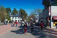 Tourists walking in Jomas Iela street, Jurmala, Latvia
