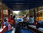 """[UNESCO WORLD HERITAGE SITE](14)<br /> <br /> MEXICAN TOURISTS on BOARD the TRAJINERA (boat) ALONG the XOCHIMILCO RIVER and the FLOATING GARDENS<br /> <br /> Xochimilco is one of the sixteen boroughs within Mexican Federal District. Today,the borough consists of eighteen neighborhoods along with fourteen villages that surround it. While the neighbhoods are somewhat in the geographic center of the Federal District, it is considered to be """"south"""" and has an identity separate from the historic center of Mexico City. Xochimilco is best known for its canals, which are left from what was an extensive lake and canal system that connected most of the settlements of the Valley of Mexico. These canals, along with artificial islands called chinampas, attract tourists and other city residents to ride on colorful gondolas called<br /> """"trajineras"""". Its Hispanic past, has made Xochimilco a World Heritage Site."""