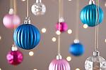 Christmas baubles hanging, studio shot