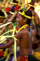 Young native women wearing traditional ceremonial costume perform the traditional stick dance in Ma Village, Yap, Micronesia.