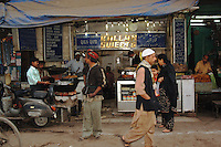 Looking into a food shop in New Delhi, India.