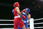Glasgow 2014 Commonwealth Games<br /> <br /> Charlene Jones, Wales (Blue) v Laishram Devi, India (red)<br /> <br /> 30.07.14<br /> ©Steve Pope-SPORTINGWALES