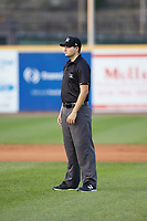 Base umpire Ben Fernandez handles the calls on the bases during the South Atlantic League game between the Lexington Legends and the West Virginia Power at Appalachian Power Park on June 7, 2018 in Charleston, West Virginia. The Power defeated the Legends 5-1. (Brian Westerholt/Four Seam Images)