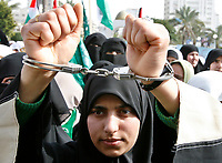 "A Palestinian Hamas supporter handcuffs herself during a protest calling for an end to Israeli sanctions on Gaza February 23, <br /> ""photo by Fady Adwan"""