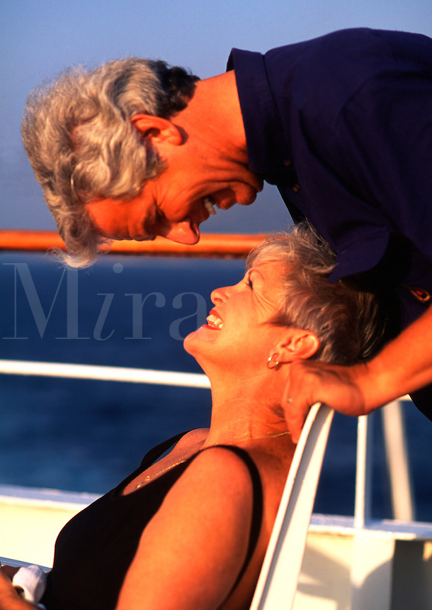 Romantic, mature couple on deck of cruise ship