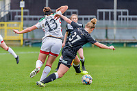 Sara Yuceil (13) of OHL and Margaux Van Ackere (37) of Eendracht Aalst pictured during a female soccer game between Eendracht Aalst and OHL on the 13 th matchday of the 2020 - 2021 season of Belgian Scooore Womens Super League , Saturday 6 th of February 2021  in Aalst , Belgium . PHOTO SPORTPIX.BE | SPP | STIJN AUDOOREN