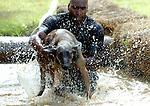 Manchester Conn. Police Officer Robert Johnson, pulls his k9 partner Dibbs from the water while struggling through the water pit as they partipate in the Connecticut Police Canine Oylmpics, Saturday, July 21, 2007 in Storrs.  Now in it's 16th year the event was held at the Depot Campus of the Unverisity of Connecticut, state and local police agencies a long with the Connecticut Department of Corrections partipated in the event with money raised going to local charites. (AP Photo/Journal Inquirer, Jim Michaud)