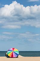 Avon, Outer Banks, North Carolina.  Beach Umbrella and Family on the Beach.