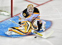 22 April 2009: Boston Bruins goaltender Tim Thomas makes a first period save against the Montreal Canadiens at the Bell Centre in Montreal, Quebec, Canada. The Canadiens, entering the contest down three games to none, were eliminated from Stanley Cup competition with the 4-1 loss and series sweep by the Division winning Bruins. ***** Editorial Sales Only ***** Mandatory Credit: Ed Wolfstein Photo
