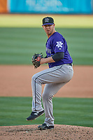 Matt Pierpont (22) of the Albuquerque Isotopes delivers a pitch to the plate against the Salt Lake Bees at Smith's Ballpark on April 27, 2019 in Salt Lake City, Utah. The Isotopes defeated the Bees 10-7. This was a makeup game from April 26, 2019 that was cancelled due to rain. (Stephen Smith/Four Seam Images)