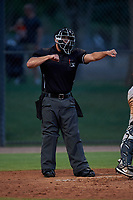 Home plate umpire Jesse Segura calls a batter out on strikes during an Arizona League game between the AZL Giants Orange and AZL Dodgers Mota on June 29, 2019 at Camelback Ranch in Glendale, Arizona. The AZL Giants Orange defeated the AZL Dodgers Mota 9-3. (Zachary Lucy/Four Seam Images)