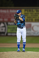 Ogden Raptors relief pitcher Wes Helsabeck (27) looks in for the sign during a Pioneer League game against the Billings Mustangs at Lindquist Field on August 17, 2018 in Ogden, Utah. The Billings Mustangs defeated the Ogden Raptors by a score of 6-3. (Zachary Lucy/Four Seam Images)