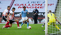 31st October 2020; Bramall Lane, Sheffield, Yorkshire, England; English Premier League Football, Sheffield United versus Manchester City; Raheem Sterling of Manchester City with the ball at his feet is tackled by John Egan of Sheffield United watched by Sheffield United Goalkeeper Aaron Ramsdale
