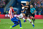 Jose Maria Gimenez of Atletico de Madrid competes for the ball with Javier Hernandez Chicharito of Bayer 04 Leverkusen during the match of Uefa Champions League between Atletico de Madrid and Bayer Leverkusen at Vicente Calderon Stadium  in Madrid, Spain. March 15, 2017. (ALTERPHOTOS / Rodrigo Jimenez)