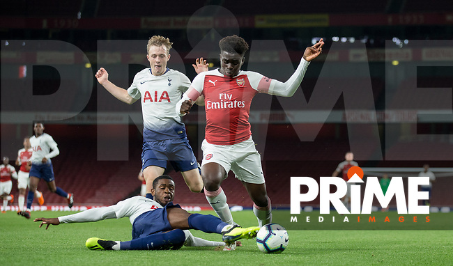 Jaden Brown of Tottenham Hotspur brings down Bukayo Saka of Arsenal for a penalty during the Premier League 2 match between Arsenal U23 and Tottenham Hotspur U23 at the Emirates Stadium, London, England on 31 August 2018. Photo by Andy Rowland.