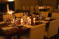 Tables set for dinner guests with wine glasses and candles The Dolly Irigoyen - famous chef and TV presenter - private restaurant, Buenos Aires Argentina, South America Espacio Dolli