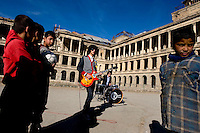 Children listen to rock band Kabul Dreams play their instruments in the ruins of a castle in Kabul. Kabul Dreams is made up of singer/guitarist Sulyman Qardash, bass player Siddique Ahmad and drummer Mujtaba Habibi, and they claim to be the country's first and only rock and roll group.
