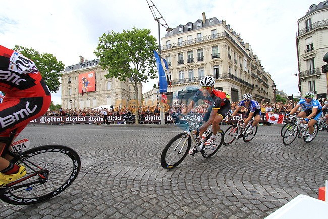 The breakaway group rounds the Arc de Triomphe hairpin for the first time during the final Stage 20 of the 2010 Tour de France running 102.5km from Longjumeau to Paris Champs-Elysees, France. 25th July 2010.<br /> (Photo by Eoin Clarke/NEWSFILE).<br /> All photos usage must carry mandatory copyright credit (© NEWSFILE | Eoin Clarke)